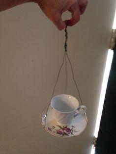 Tea cup and saucer bird feeder