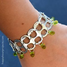 Scavenge the pop tabs off your soda cans to make this recycled jewelry piece! Soda Pop Tab Recycled Bracelet Tutorial at www.happyhourprojects.com