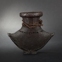 Braided basket-weave vase | South China ethnic. |  20th Century.
