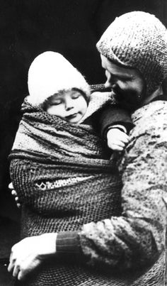 Warsaw ghetto, Poland, summer 1941. A woman holding a child.