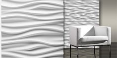 Textural Designs Zen Gypsum Tile is featured in the kitchen backsplash. It's absolutely striking against the dark woods. We love it!