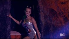When she crawled down the stairs with her tongue out: | The 15 Weirdest And Craziest Moments From Miley Cyrus' VMA Performance