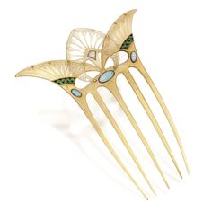 GOLD, TORTOISESHELL, OPAL AND ENAMEL HAIR COMB, GEORGES FOUQUET, FRANCE, CIRCA 1905-1908. The carved tortoiseshell comb of ancient Egyptian inspiration with lotus and papyrus motifs, set with opal cabochons, accented by black and green enamel,
