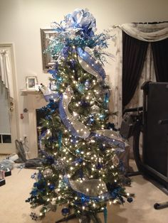 blue and silver decorated christmas tree i made for a co workerfriend december - Silver And Blue Christmas Decorations