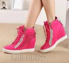 It is a pair of sneakers with heels. They are beautiful, tall triangular-shaped, fashionable, pink originating in mexico, made of leather and the purpose of walking comfortably