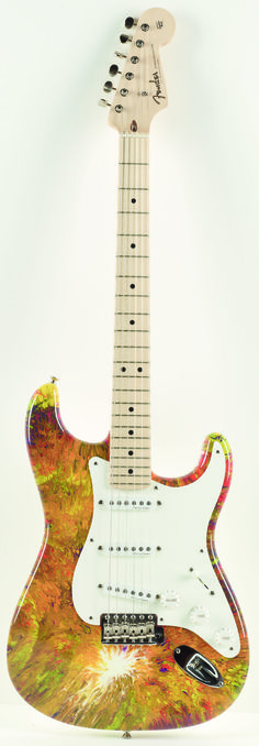 This Fender guitar belonging to Eric Clapton and painted by Alex Echo sold at auction for £20,000 to benefit The Crossroads Centre, a recovery facility in Antigua founded by Clapton.