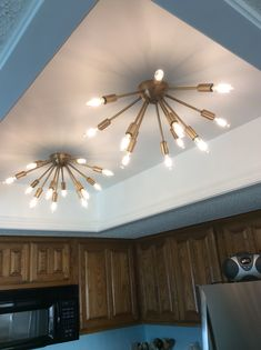Fluorescent light box conversion. Sputniks from lights.com Kitchen Ceiling Lights, Kitchen Lighting, Condo Remodel, Kitchen Remodel, Diy Outdoor Kitchen, Condo Decorating, Home Workshop, Office Makeover, Do It Yourself Home
