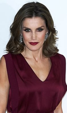 QUEEN LETIZIA OF SPAIN  The Spanish Queen gets extra points for going with all out sultry glam – something we don't get to see very often at royal events! Forget about having to choose between strong eyes or lips – with her dark smokey shadow and unabashedly bold burgundy lip color at a journalism awards gala on October 26, Queen Letizia showed you can do both to dramatic effect.