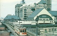 Pullman Trolley #250 crossing trestle over Illinois Central Station to Grant Park Loop and Museum in 1951. Trestle built 1933, demolished 1974.trolley over trestle.jpg (824×526)