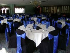Black Chair Covers/Royal Blue Sashes