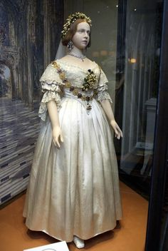 Queen Victoria's wedding dress and wedding shoes. She set the fashion for white bridal gowns, which has continued to this day.