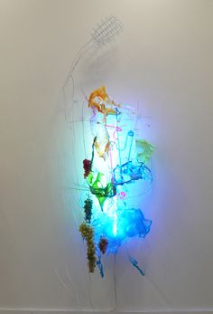 Judy Pfaff Golden Honey, 2012  Steel wires, various plastics & papers, plastic grapes, and fluorescent lights 105 x 38 x 24 inches  www.BrunoDavidGallery.com