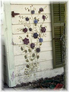 Faux morning glory made from repurposed water valve handles....