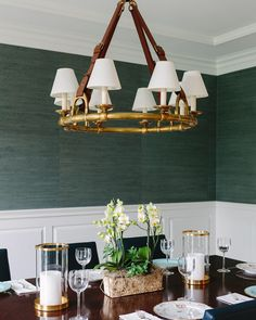 This dining room is a favorite. The green Phillip Jeffries grasscloth wallpaper provides a natural texture and a pop of sophisticated color. The brass and leather chandelier from Ralph Lauren adds classic all-American design. Grasscloth Dining Room, Dining Room Wallpaper, Dining Room Walls, Home Wallpaper, Ralph Lauren Home Living Room, Green Dining Room, Dining Lighting, Room Interior Design, Home