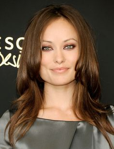 Olivia Wilde has my exact eye color... make it pop with warm orange copper and a little apricot to contrast with the cool light blue/green -JessLove