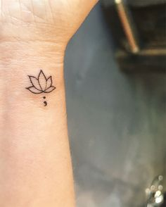 Lotus flower semicolon tattoo