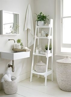 Go with an all-white decorating scheme to make your bathroom feel more spacious. A slim tapering ladder shelf unit, like this from The White Company, provides essential storage. Decorate the bathroom with potted plants and bud vases to add a natural touch Bad Inspiration, Bathroom Inspiration, Interior Inspiration, Bathroom Inspo, Interior Ideas, Interior Design Ideas For Small Spaces, Bathroom Ideas Uk, Bathroom Styling, Decor Room