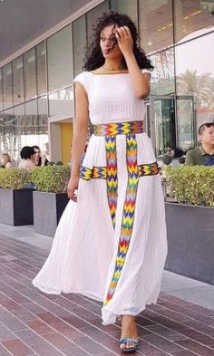 High Quality Hand Woven Ethiopian Traditional ClothItem Available on Order. Order now your Modern Ethiopian traditional dress Latest Traditional Dresses, Traditional Dresses Designs, Traditional Outfits, Ethiopian Wedding Dress, Ethiopian Dress, Ethiopian Flag, Ethiopian Beauty, Ethiopian Traditional Dress, Traditional Hairstyle