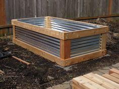 raised bed made of cedar and corrugated metal roofing.