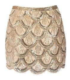 Flapper Riches Skirt: Features a double layer design with tonal liner for full coverage, all-over gold sequin detailing highlighting intricate scalloped lines throughout, and a hidden rear zipper to finish.
