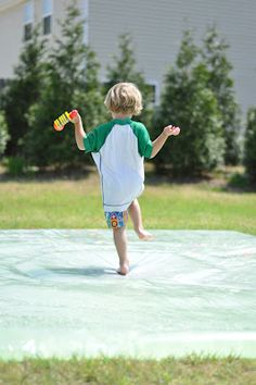 """""""I-Spy"""" outdoor waterbed originated at Play at Home Mom. Put objects inside for an I-Spy Game or Treasure Hunt"""
