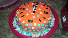 New Years Eve cake of a clock striking midnight & confetti. It is orange because my son loves the color orange.