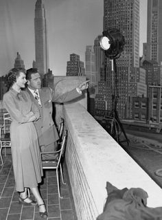 """James Whitmore points out buildings of the Manhattan skyline to British actress Deborah Kerr on a Hollywood sound stage, Sept. 18, 1949. The backdrop was prepared for a scene in \""""Please Believe Me.\"""""""