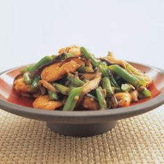 Sweet sour and spicy stir fried orange chicken with broccoli and cashews