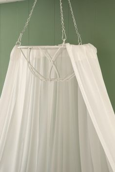 Make your own bed or ceiling canopy: Remove the inner lining from a hanging basket. Spray the basket with white spray paint, and allow to by samantha - Click image to find more DIY & Crafts Pinterest pins