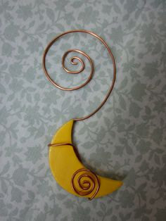 hand shaped recycled copper wire/clay moon ornament. $9.00, via Etsy.