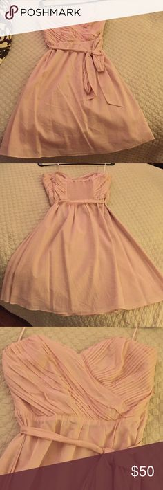 Strapless pink sweetheart top dress with tie Only worn once! Sweetheart neckline gives an instant classic look to this cocktail dress. Wraparound tie adds definition to the waistline. Zipper and eye and hook clasp on the left side. Dress is lined. 100% cotton. Lining on the inside is 95% polyester and 5% spandex. Material does wrinkle easily but otherwise light and comfortable. Express Dresses Strapless