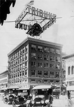"""Formerly the Breuner\'s Furniture Company, the Tribune moved into the building at and Franklin Streets on March Here the windows are decorated with flags for the dedication March (Edward \""""Doc\"""" Rogers / Oakland Tribune) Oakland California, Vintage California, California Love, Northern California, Oakland Tribune, East Bay Area, Newspaper Photo, Oakland Museum, San Ramon"""