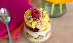 Sweet, creamy yogurt; crunchy granola with a nutty-ginger bite; fresh, juicy mango; bittersweet, tangy berries; sesame honey cashews – layers that lead your mouth <em>through the looking glass</em> (apologies, Mr. Carroll).