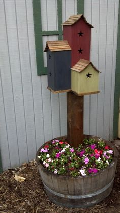 Make one with solar light Instead...Triple Birdhouse in Whiskey Barrel add cabin number.
