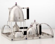 JOSEF HOFFMAN tea service designed for the Stoclet Palace in 1903, silver, with applied stylized S monograms, executed by the Wiener Werkstätte. Currently in the collection of Nelson Blitz and Catherine Woodard.