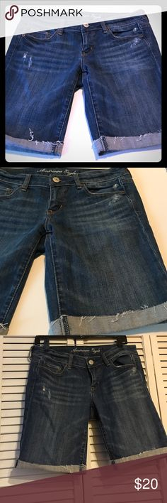 Distressed Bermuda shorts by AE size 8 Wonderful condition are these distressed American Eagle Bermuda shorts. Size 8. Waist measures 33 inches lying flat. These jeans do have stretch to them. American Eagle Outfitters Shorts Bermudas