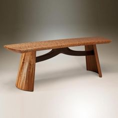 """Custom made bench. The curved legs are coopered in mahogany with wenge edge detailing. The seat of premium quilted maple is softened by a gently curved shape. The structural heart of the piece is the sculptured and curved wenge stretcher. 46""""w x 14""""d x 16""""h"""
