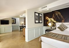 """2 Bedroom Suite: Inspired by a famous painting of Caravaggio """"Amor Vincit Omnia"""", the stylish 2 Bedroom Suites are decorated in the warm tones of dove-gray. 2 Bedroom Suites, Rome Hotels, Hotel Indigo, Executive Suites, Luxury Rooms, Hotel Deals, 5 Star Hotels, Contemporary Style, Caravaggio"""