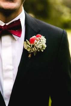 Red boutineer and polka dot bow tie    we ❤ this!  moncheribridals.com   #groomsuits