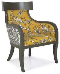 I love the combination of fabrics on this accent chair. I see a pair floating out in the middle of the room or anchoring a dining table.