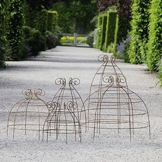 Pretty wire supports for vegetables or flowers by using tomato cages upside down and curling the end wire-