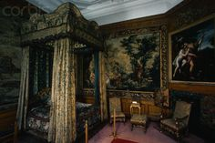 Queen Elizabeth's Bedroom at Burghley House  A draped four-poster bed in Queen Elizabeth's Bedroom at Burghley House, built between 1565-1587 by William Cecil. N