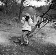 http://500px.com/photo/188717687 Big Camera Little Girl by tjweitzman -_Shot on Ilford FP4 film - November 2014_  Another shot of my daughter the young photographer shooting me with the not-so-small Canon 24-105L a few years ago ; )   Exposed at DeSoto State Park and falls in north Alabama.  Your thoughts are always welcome and appreciated.  Thanks for the support!  _Machine Developed by The Camera Doctor in Decatur GA - Epson V600 Scan - Lightroom Edit_. Tags: portraitgirltreefilmblack and…