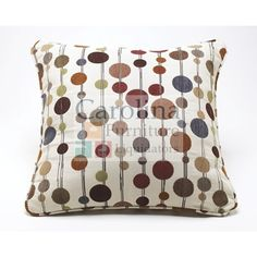 "The Ashley Signature Design ""Hodgepodge"" Decorative Pillow features multiple colors and a contemporary style."