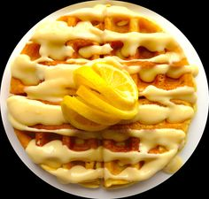 Who is hungry for waffles? How about a waffle topped with a bright and citrusy, sweet and zesty lemon glaze? Sounds amazing, right?  This light and fresh lemon glaze recipe is simple, quick, and easy! Your family will love a new twist on waffles and will definitely ask for more!