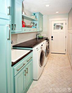 Laundry room: Fun aqua cabinets, wood counter and herringbone marble floor. Aqua Laundry Rooms, Laundry Room Cabinets, Aqua Paint, Blue Paint Colors, Cabinet Paint Colors, Painting Cabinets, Stacked Washer Dryer, Kelly Moore, Acapulco