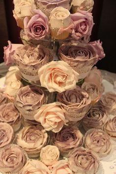 Piped buttercream rose cupcake tower by Victoria's Kitchen, via Flickr Hard to tell the difference between the real roses and the frosted cupcakes!
