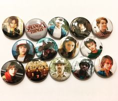 """This is a set of fourteen 1"""" pinback buttons featuring the characters from Stranger Things! Multiple sets available, just send me a message!"""