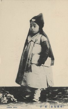 """Colonial period postcard. """"Korean child."""" A boy with pad of paper."""