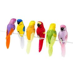 Tropical Birds Home, Garden, Party or Retail Decoration. Use these neat clip on birds to brighten up table centres at your tropical party! Our stunning decorative birdies come in packs of 6 and will clip to anything to create a fun fiesta carnival feeling at any special occasion. Dimensions: 170 x 145 x 40mm Pack of 6